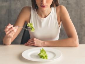 74490974 - eating disorder. cropped image of girl eating lettuce