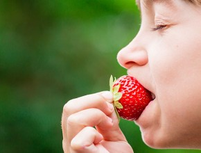 young-girl-eating-strawberry